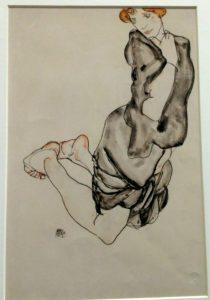 Egon Schiele Museum: Kneeling Woman in a Gray Dress, 1912